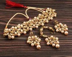 Brass Party Wear Golden Pearl Necklace Earrings Set