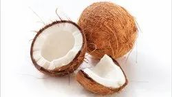 A Grade Solid Brown Husked Coconut, Packaging Size: 50 Kg