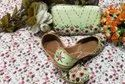 Partywear Punjabi Jutti With Matching Clutch With Multi Flower Work.