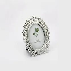 Regally Fashioned Carved Silver Photo Frame