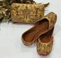 Partywear Golden Color Jutti With Matching Clutch
