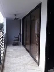 Partition Doors Wood Finish UPVC 9 feet 3 Track Glass Panel Sliding Door, For Home, Exterior