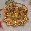 Metal Gold Plated Laxmi Ganesh Saraswati Statue With Diya