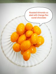 Round Orange Flavored Coated Roasted Chocolate Almonds, Packaging Size: 1 Kg