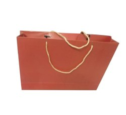 Red Handle Type: Loop Handle Paper Carry Bags, For Shopping, Capacity: 2kg