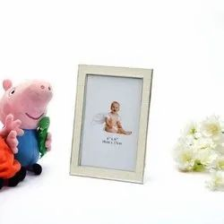 Meticulously Crafted Peach Colored Baby Photo Frame