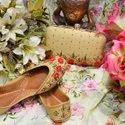 Golden Color Punjabi Jutti With Maching Clutch With Thread Work.