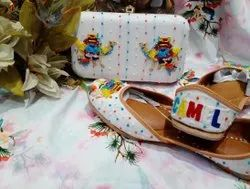 Women White Colour Punjabi Jutti With Maching Clutch With Handwork.