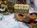 Partywear Golden Color Punjabi Jutti With Clutch With Kundan Work.