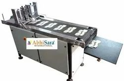 Abhisara International Carton Feeding Machine
