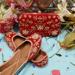 Bridal Red Color Punjabi Jutti With Matching Clutch With Handwork.