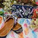 Blue Punjabi Jutti With Maching Clutch With Handmade Work.