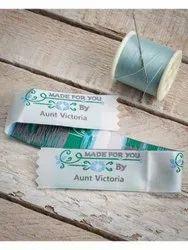 White cotton garment strip woven label