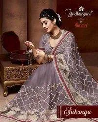 Ardhangini Sukanya Net Fabric Fancy Saree Catalog Collection
