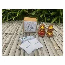 Ganesha And Lakshmiji Idols With Marigold And Tulsi Seeds