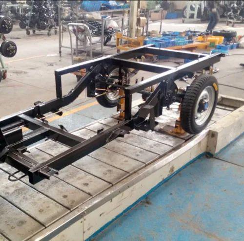 In floor slat conveyor