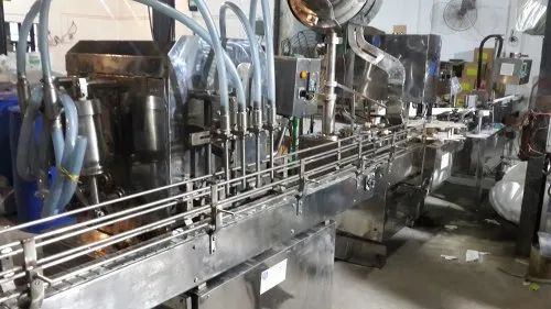 SNR Pet / Glass Bottle Packaging Machine, 5Kw, Capacity: 30ml To 1000ml