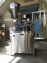 automatic shrikhand cup filling and foil sealing machine