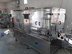 Automatic volumetric liquid filling and capping machine (monoblock)