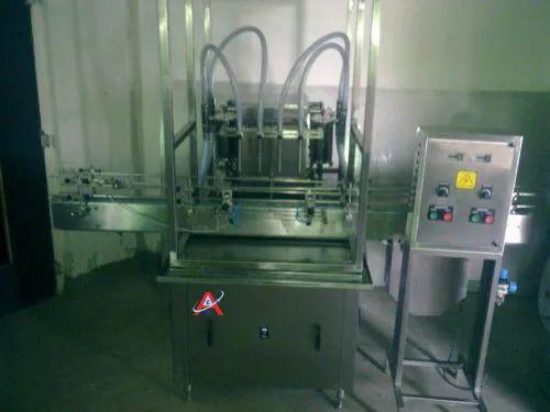 AUTOMATIC 4 HEAD VOLUMETRIC LIQUID FILLING MACHINE