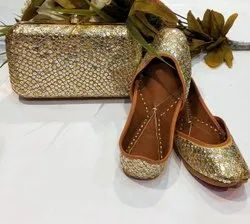 Partywear Golden Color Punjabi Jutti With Clutch With Handwork..