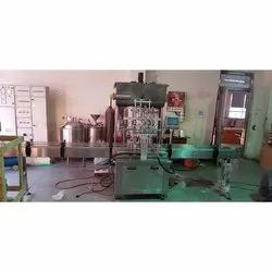 Glass Bottle Filling And Sealing Machine