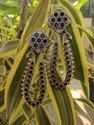 Color Brass And Stone Jhumka Earrings