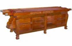 Walnut Finish Wooden Dhroni On Open Shelf Table