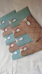 Handmade Paper Multi Pocket Fold Pebble Embossed Wedding Invites, Size: 6*9