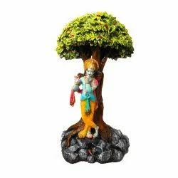 Lord Krishna Statue Under The Tree
