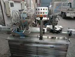 Automatic Liquid Filling And Cap Sealing Machine.