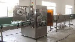 High Speed Sleeve Label Applicator With Steam Tunnel