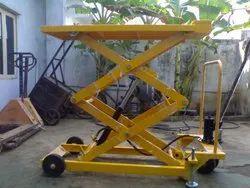 Yellow Scissor Lifting Equipment, For Industrial Premises, Capacity: 1000 Kg
