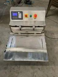 Horizontal Nozzle Type Chamber Less Vacuum Packing Machine
