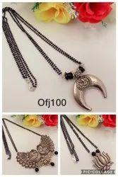 Oxiidised long chain jewellery