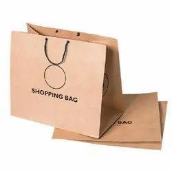 Brown Loop Handle Printed Paper Shopping Bag, Capacity: 4 Kg
