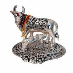 White Metal Kamdhenu Cow Calf Statue For Decoration & Gifting Purpose