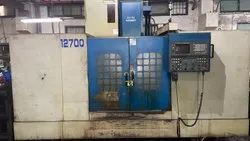 Old And Used Make Twin Horn Vertical Machine Center With 4 Axis