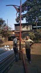 Single arm decorative pole