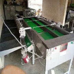 APPLE BRUSHING AND GRADING MACHINE
