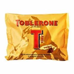 Yellow Packet Toblerone Tiny Swiss Milk Chocolate Honey & Almond Nougat 200 Grams, For Consumption
