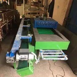 FRUIT BRUSHING AND GRADING MACHINE