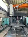 Old And Used Make Feeler Sdm 4210 Cnc Double Column Vmc With 90 Degree Head