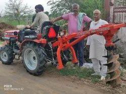 Mitsubishi Tractor post hole digger