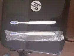 Medium Plastic White Toothbrush