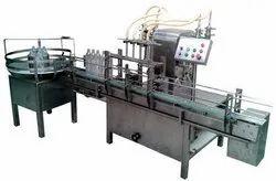 Automatic Bottle Filling Machine.