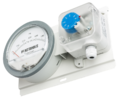 Differential pressure gauge with alarm switch