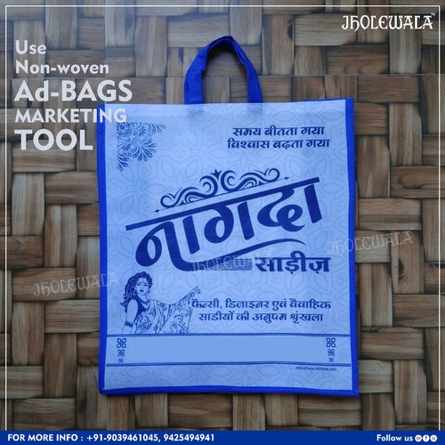 Promotional Bags White + Blue Non woven Printed Customized/Bags, Capacity: 10kg