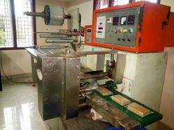 Chikki,Peanut Bar, Cake Packing Machine