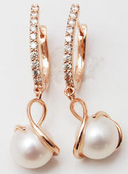 pearl dangling designer diamond hoops 18 k rose gold earrings